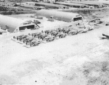 The old Brisbane Airport with American war planes lined up.  Circa 1940s.