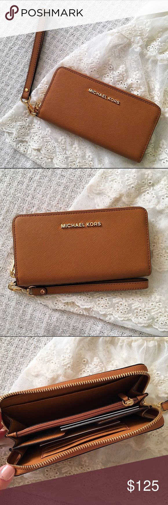 Michael Kors Jet Set Tech Wallet/Wristlet Authentic MK tech wallet/wristlet, brand new with tags. Gorgeous camel color that will go with any purse with gold detailing and lettering. Fits most smartphones, has several credit card pockets, pocket sleeves, sleeves for bills, and a coin sleeve. Wristlet strap is removable so it can be used interchangeably as a wallet or wristlet. Make an offer! Will ship next business day.  Michael Kors Bags