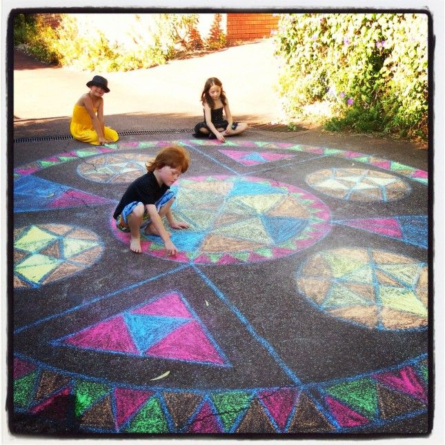 The kids colouring a huge Rainbow Mandala