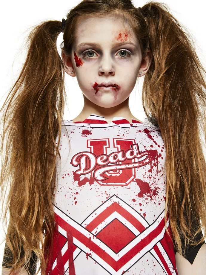 Mix spooky with cute with this zombie cheerleader costume for kids. Pick it up from partydelights.co.uk and complete this easy Halloween costume with fake blood.
