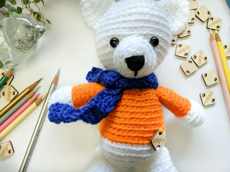 Soft, cute teddy bear for a football fan. BSU colors! Created with love in smoke free home and is looking for loving hands.<3  I used white, blue and orange acrylic yarn to make this bear and stuffed it with polyfil, used black safety eyes. It can be washed in cool water, gentle cycle and can be put in the dryer.  Size - 10'' tall, 8'' tall when sitting, 7'' paw to paw. #amigurumi #toys #crochet #crocheting #toy #teddybear #teddy #boise #idaho #orange #nursry #nurserydecor