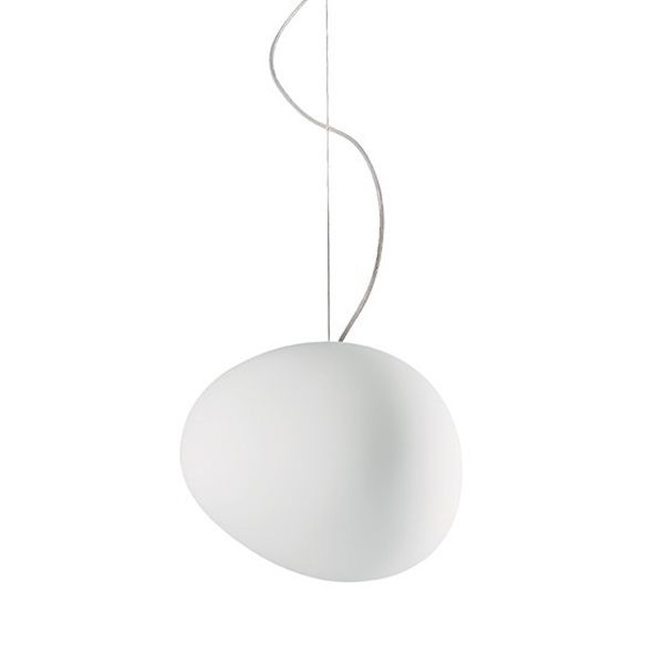 The Gregg from Foscarini and designed in the year 2007 by Ludovica and Roberto Palomba is a glowing, stone-shaped pendant lamp. This pendant lamp doesn't use pure geometry.