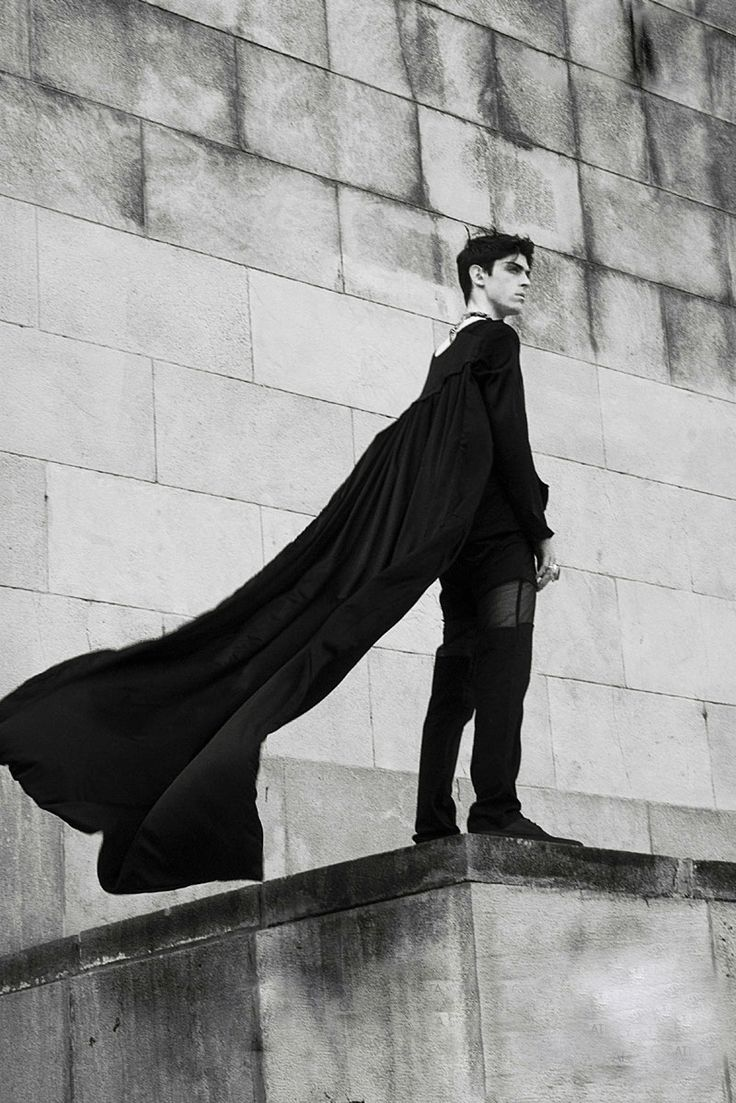 """""""I looked up and saw him. Rowan. My friend, the one we thought was dead, was standing on the ledge....wearing a cape?"""""""