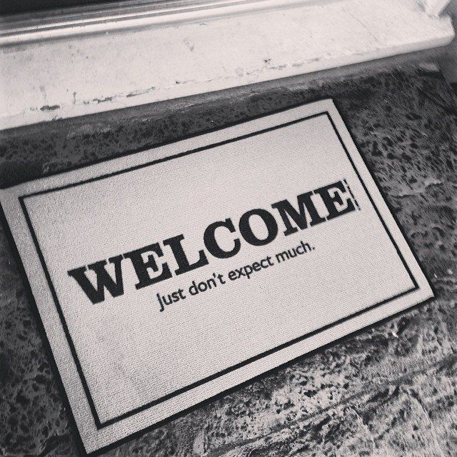 "Welcome Just Don't Expect Much Doormat / This ""Welcome Just Don't Expect Much"" Doormat from High Cotton is a great way to make guests feel welcome while tamping down their expectations. http://thegadgetflow.com/portfolio/welcome-just-dont-expect-much-doormat/"