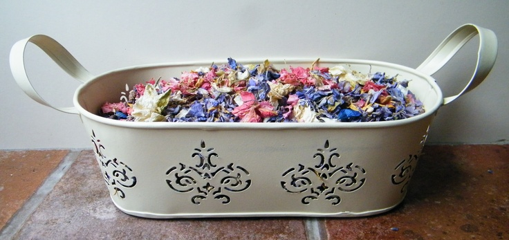 Small decorative cream metal trough filled with delphinium petal confetti - makes a change from confetti cones & baskets http://www.daisyshop.co.uk.