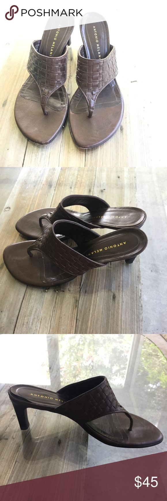 Antonio Melani heeled flip flops dark brown These Antonio Melani heeled flip flops are so cute and in extremely good condition. The sole of the left shoes is slightly lifted up at the heel, but I think I can fix that. They are so cute, and are in need of a good home. Size 6 & 1/2 ANTONIO MELANI Shoes Sandals