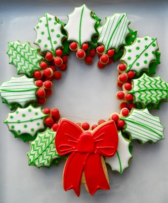 Christmas Cookies: Holly shaped cookies decorated using royal icing arranged in to the shape of a wreath.