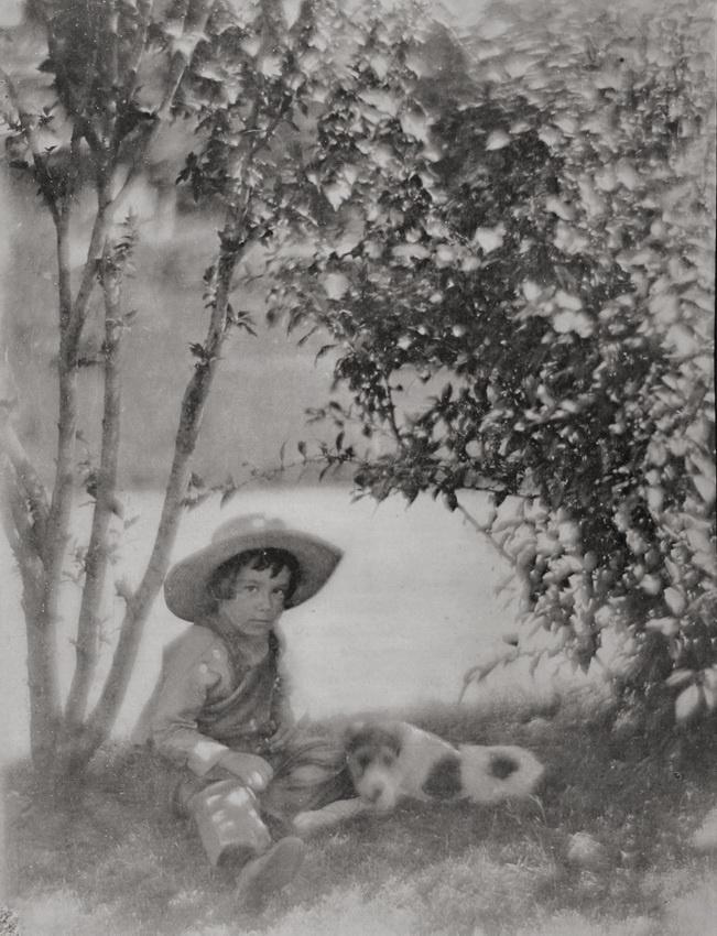 Little boy with dog.   c1909 (photogravure).   Photographer: Gertrude Käsebier, USA