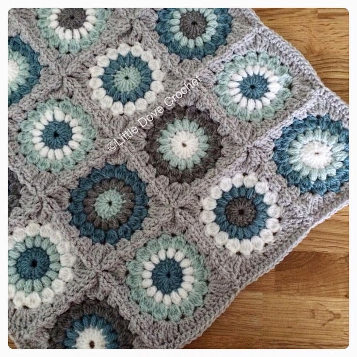 Oh finding it hard to capture these colours! Stylecraft Special DK in silver, grey, storm, duck egg and white (sunburst square original pattern by Priscilla Hewitt) From Little Dove Crochet