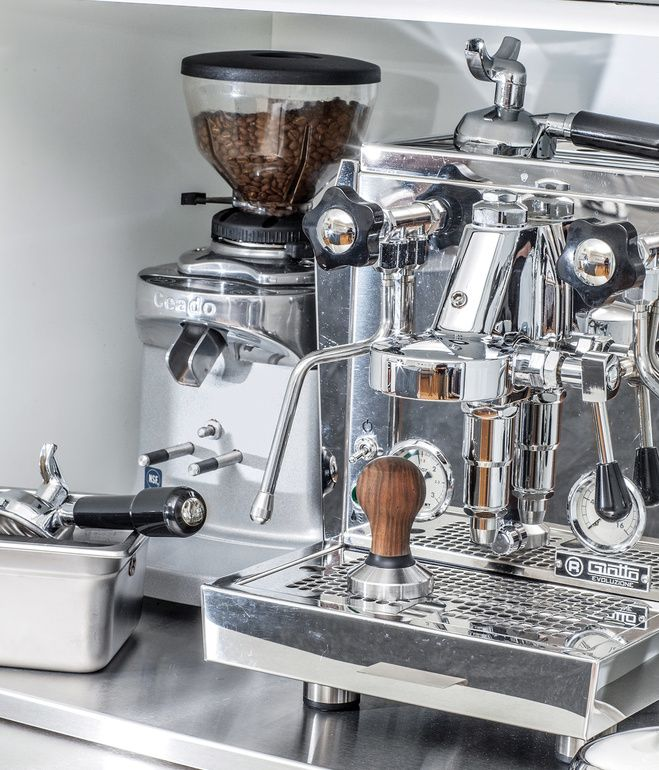 Coffee station featuring a professional-grade Rocket Espresso machine.