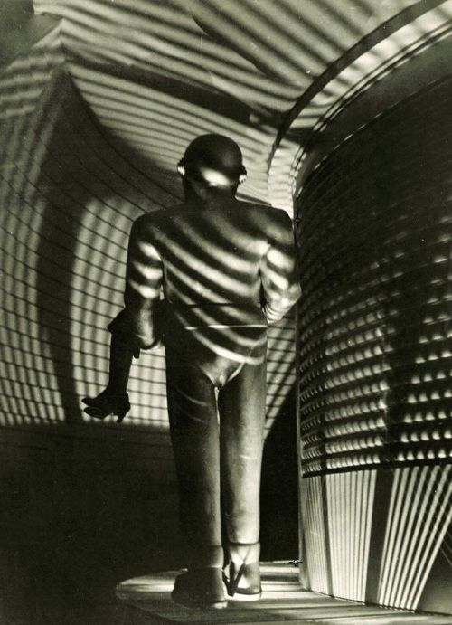 The Day The Earth Stood Still (1951, dir. Robert Wise) -Gort escorts Patricia Neal to his space shuttle