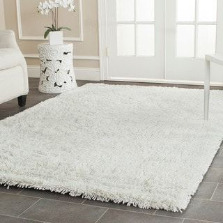 Shop for Safavieh Classic Ultra Handmade White Shag Rug (6' x 9'). Get free shipping at Overstock.com - Your Online Home Decor Outlet Store! Get 5% in rewards with Club O! - 13385122