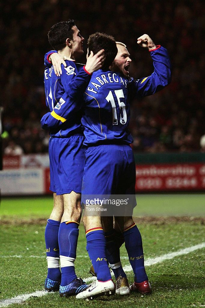 Freddie Ljungberg of Arsenal celebrates with Francesc Fabregas and Robin Van Persie after scoring his second goal during the Barclays Premiership match between Charlton Athletic and Arsenal at The Valley on January 1, 2005 in London, England.