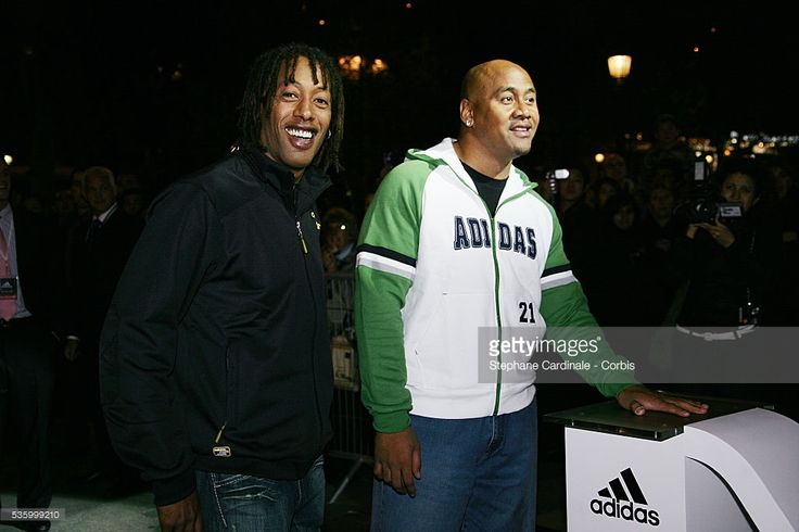 French handball player Jackson Richardson and New Zealand-born rugby player Jonah Lomu attend the opening of the Adidas store on the Champs-Elysees.