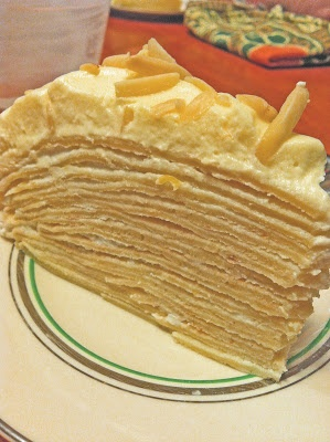 Sunshine Gâteau du Crêpe - Crepes layered with chevre and honey cream, and topped with a cloud of lemon curd cream.