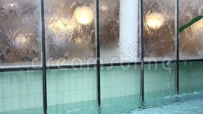Flowing water on glass - decorative glass with water flowing.