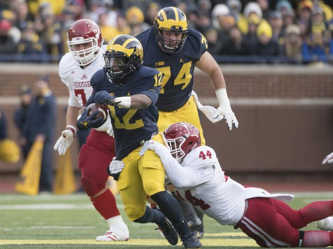 Michigan running back Chris Evans is tackled by Indiana's