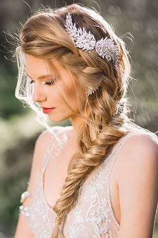 This incredible wedding day hairstyle features a boho fishtail braid! Visit our blog for more wedding hair inspiration!