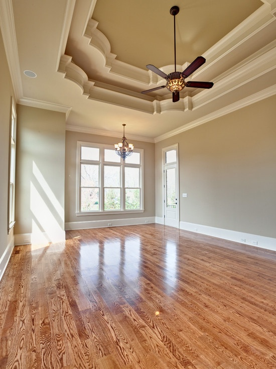 trim work is amazing love the floor color! Perhaps sand and re-stain our floors.