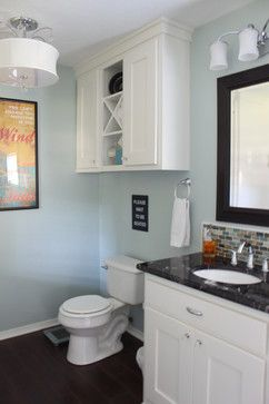 Bathroom storage above toilet cabinet, X detail, chandelier, SW Copen Blue, glass mosaic backsplash, shaker cabinets, white cabinets