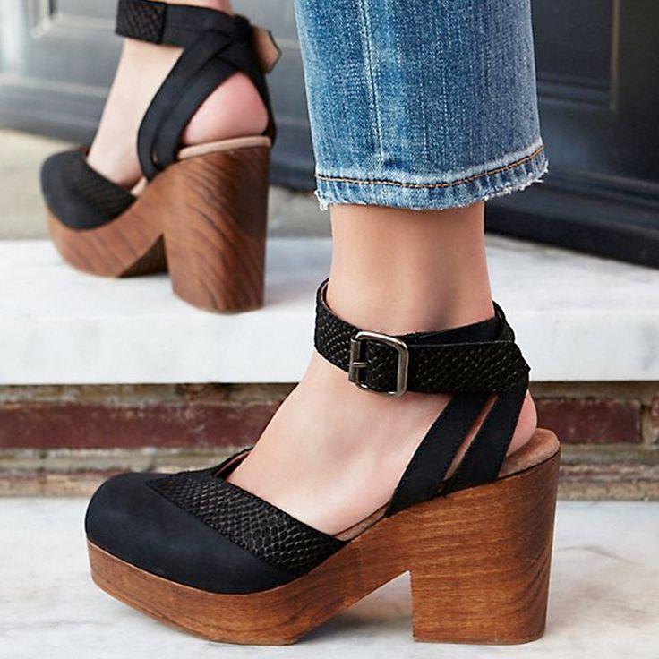 """Made from the finest Spanish leather, these wooden platform clogs feature aquare toe with a contrast leather trim. They have an adjustable ankle strap and the head measures 4"""""""