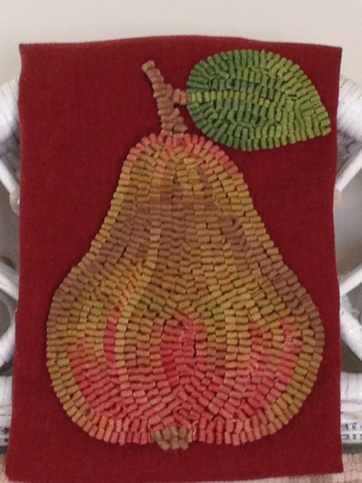 Pear hooked onto wool.