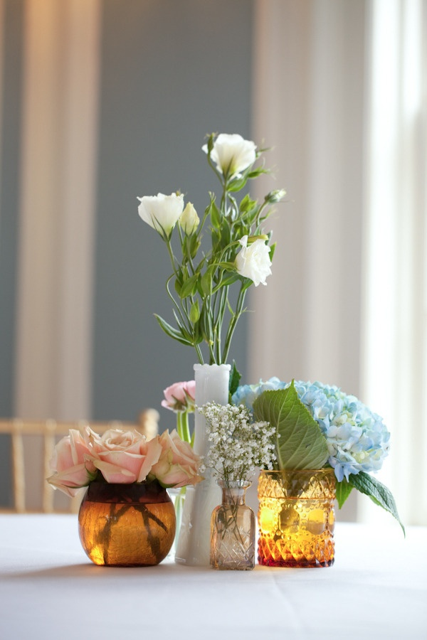 eclectic mix of mis-matched glass and ceramic centerpieces