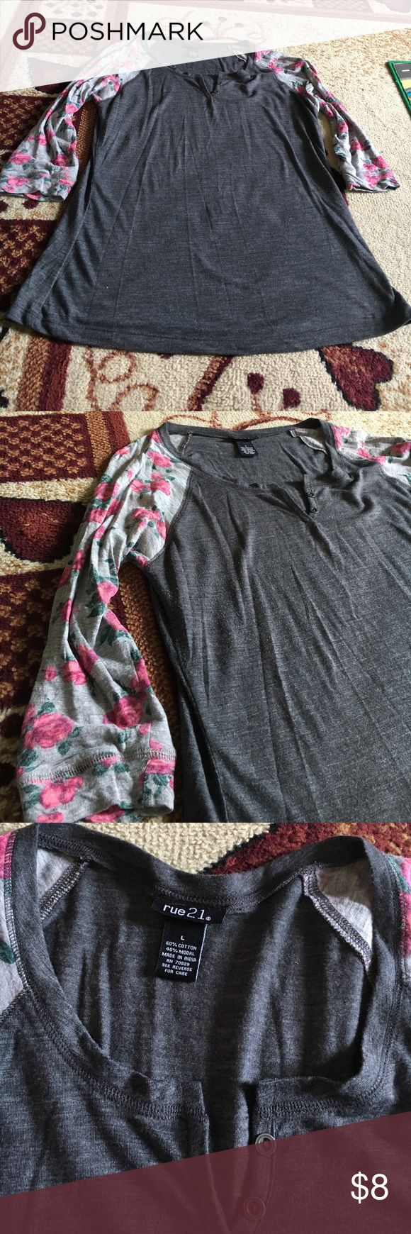 Half sleeve shirt Rue 21 1/2 sleeve rose printed shirt size large the shirts gray with light gray sleeves with pink roses great condition very comfortable shirt Rue 21 Tops