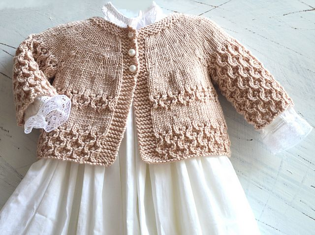This sweet little jacket is knitted from the bottom up, sleeves worked on the flat and then joined to the yoke, which means minimal seaming, and is perfect for dressing up any outfit. Would certainly dress up baby's Christening outfit if knitted in traditional white.