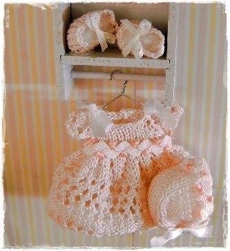 Miniature handmade baby clothes and booties. Exquisite!
