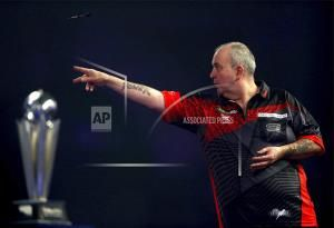 Phil Taylor loses world final in last darts game