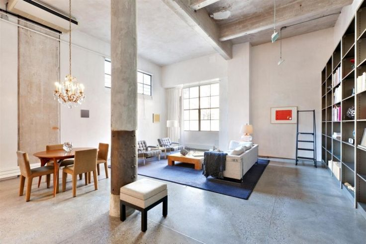 Loft : Two Floor Loft Idea with Three Bedroom in West Village New York City - Spacious Open Loft Living Area in West Village showing Oval Wooden Dining Table and Chairs and Crystal Pendant Lamp also Huge Modular Bookshelf Unit and Fabric Sofa medium version