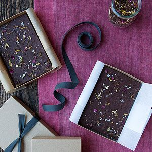 Chocolate Tea Bark Send guest home with a sweet reminder of tea time. Pack bars of this easy tea-topped bark in parchment and kraft boxes.