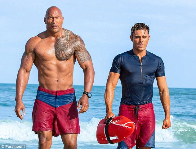 Hitting back: Dwayne 'The Rock' Johnson, 45, has taken to Twitter to fire back at those criticising his latest movie Baywatch - where he stars alongside Zac Efron (pictured above)
