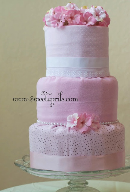 """All kinds of diaper cake tutorials.  Love this """"fondant"""" style diaper cake"""