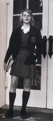 school uniform Jodie Foster wore it short but when I was going to school and wore a uniform it had to hit your knees.....