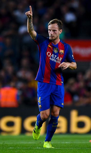 Ivan Rakitic of FC Barcelona celebrates after scoring his team's first goal during the La Liga match between FC Barcelona and Club Atletico de Madrid at the Camp Nou stadium on September 21, 2016 in Barcelona, Catalonia.