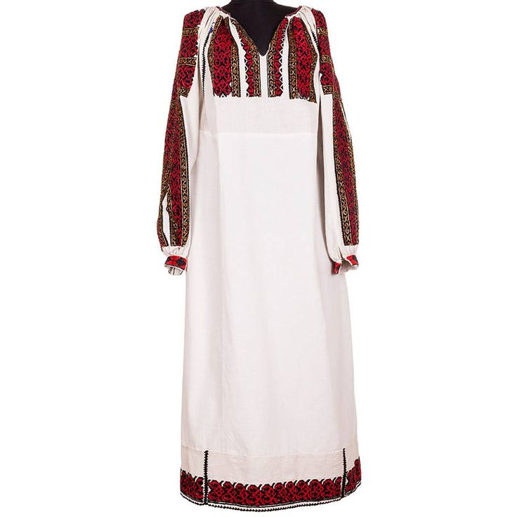 A piece of traditional Romanian clothing hand sewn in the first half of the 20th century (1935-1945), originally from Argeș. It is a garment made of cotton cloth, decorated with red and black cotton thread and yellow beads. The blouse is a special item, enriched with precious elements. #florideie #fashion #traditional #red #colorful #design #romania #brand #motifs #gold #dress #woman #vintage #handmade #embroidery