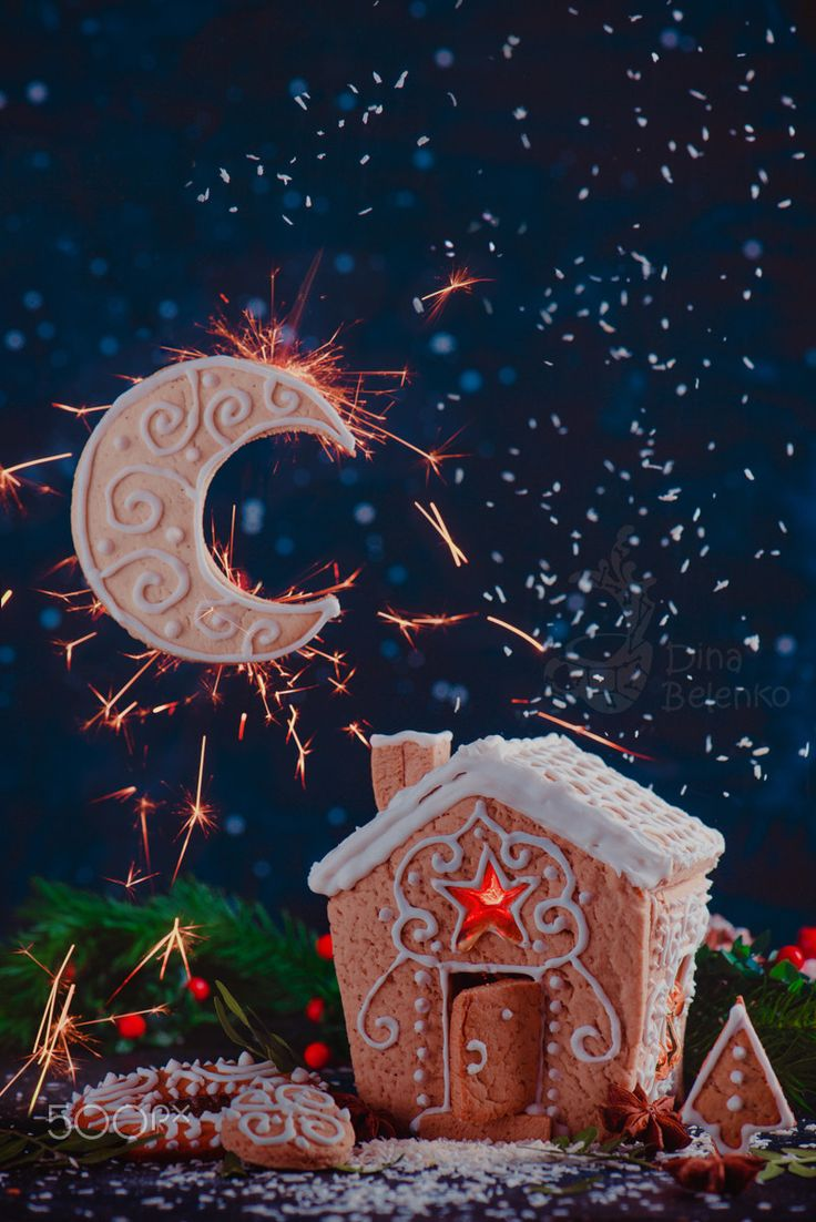 Moon and Stars - Gingerbread house with shining windows, Moon crescent from a biscuit and sparkles in a night scene with the starry sky. Christmas family baking concept. Copy space. My Instagram page with new photos and work in progress. Мой канал в Телеграм на русском о вдохновении, грифонах и натюрмортах.