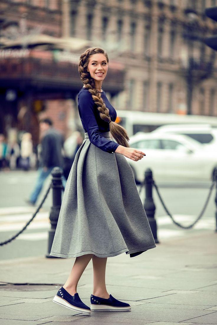 Hiplength chestnut fishtail braid, pink smile, long-sleeved indigo blouse, grey tea-length skirt