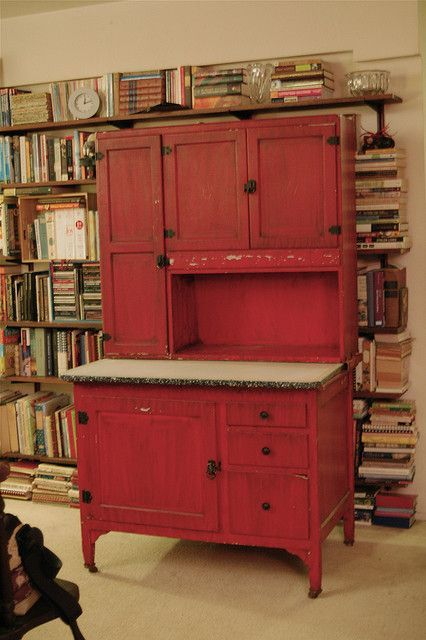 Old Red Hoosier...from the 1930's.  The problem is, even if you found a cheap particle board reproduction of that, it would cost $1,500. If you want character in your home, you either have to be (or know) a carpenter, or haunt estate sales.