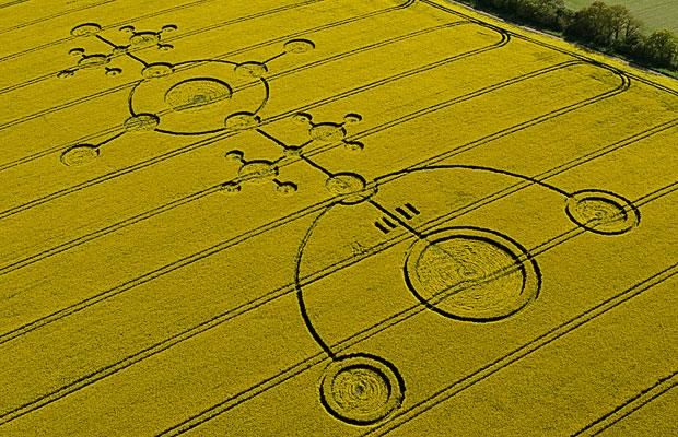 Usually found in fields of corn or barley, crop circles have begun appearing in yellow rapeseed fields across Wiltshire. Clatford, Wiltshire, created 4th May 2009.