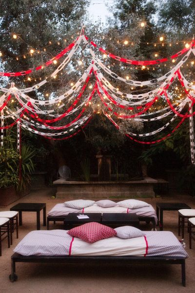 Red and white paper chain garland, and lights for lounge.