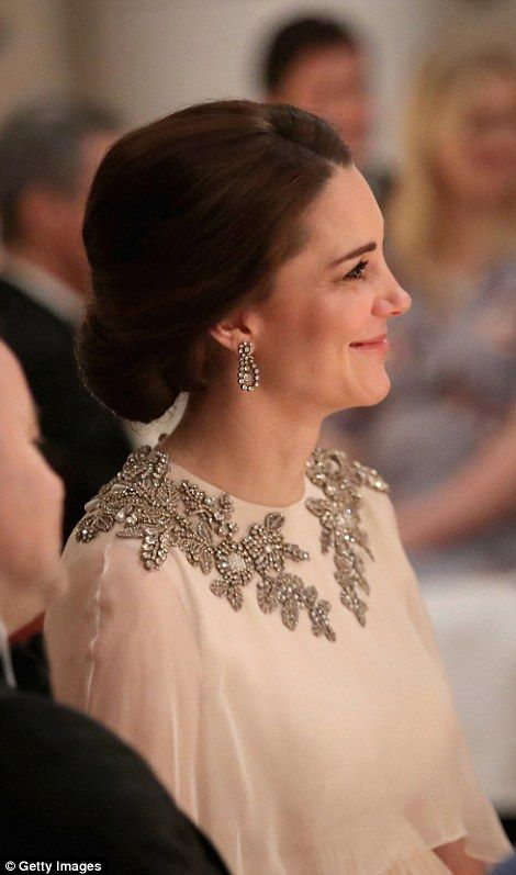 The Duchess looked like she was enjoying the anecdote of the speaker