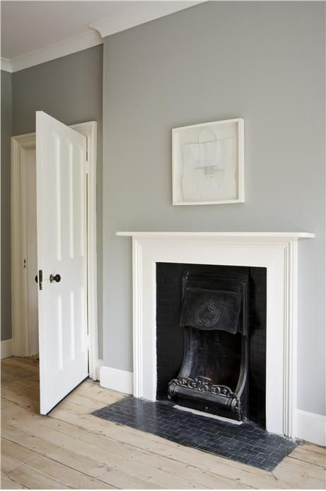 An inspirational image from Farrow and Ball Lounge with walls in Lamp Room Gray Estate Emulsion, woodwork in Wimborne White and ceiling in All White Estate Emulsion.
