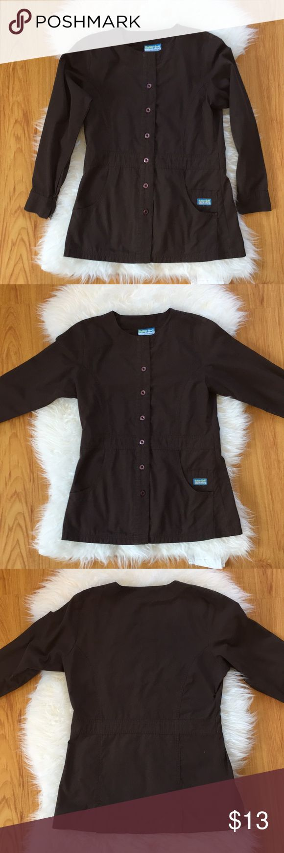 Butter-Soft by UA nursing uniform scrub jacket Buttersoft by Uniform Advantage XS button front uniform nursing scrub jacket   Scrub jacket is 65% polyester and 35% combined cotton and is best described as a chocolate brown   Scrub jacket is very well cared from and from a smoke-free home   * Bundle with my any of my other Butter-Soft scrub jackets for even greater savings! Butter-Soft by UA Jackets & Coats