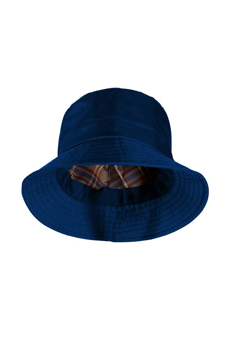 Comfort yourself on rainy days with the dry thought that  life would be even wetter if you lived in the United  Kingdom, where it rains every month of the year, from the  southern tip of England, to lush Welsh and Irish valleys,  and the soaking Scottish  Highlands. 100% waterproof hat with wide brim and plaid  lining keeps you happily dry and stylish, even in downpours.  Blue or burgundy; women's sizes S, M and L. Polyester and  acrylic; wipe clean