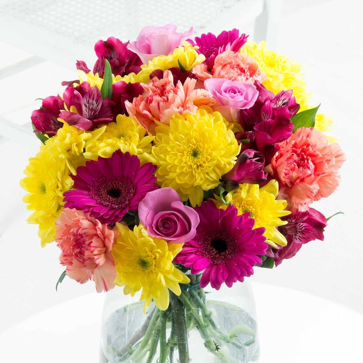 Vibrant New Baby Bouquet - A stunning arrangement of blooms in beautiful, warm tones, this bouquet is the perfect way of welcoming the new baby.