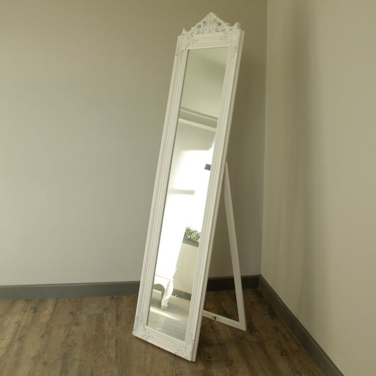 Ornate White Freestanding Mirror The frame is made from wood with a layer of plaster