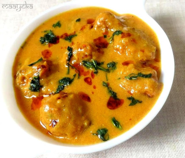 Kofta made from hung curd in cooked in tomato gravy